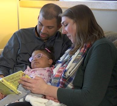 Nate and Lora Chapman read to their daughter Olly Belle