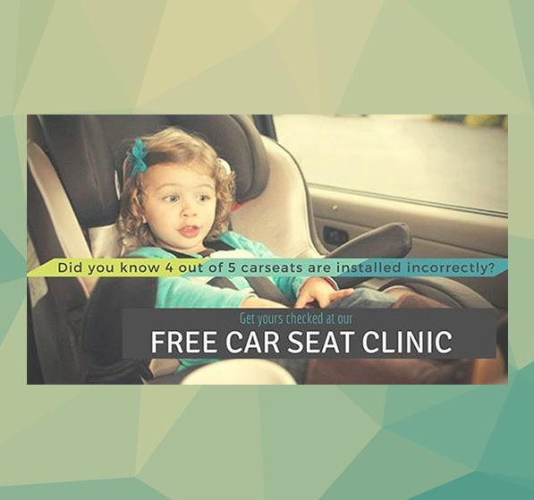 Small girl strapped in car seat